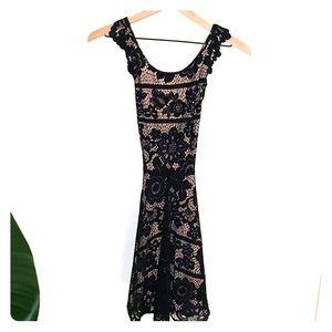For love and lemons open back black lace dress